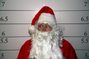 Santa dealing with an arrest booking photo after being stopped by police in Tucson Arizona