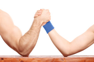 fighting criminal charges in court without a Tucson lawyer is like arm wrestling a much stronger person